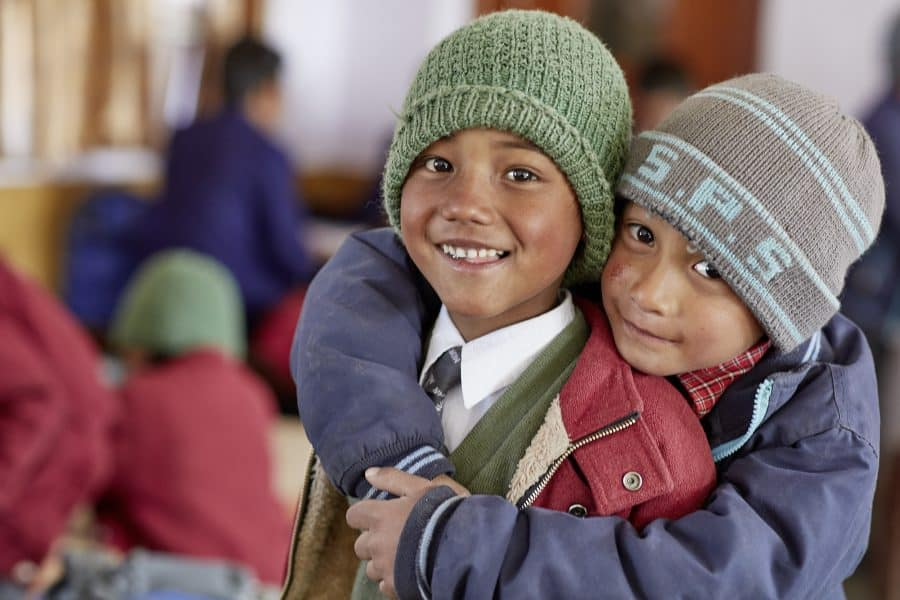 Two boys hugging from the Ladakh Children's Home run for Nepali migrant workers children by Himalayan Life in Leh, Ladakh